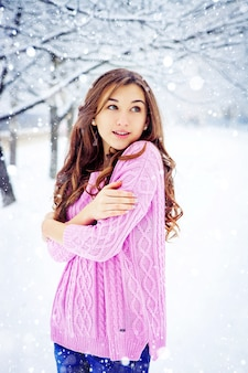 Young beautiful girl on a walk in winter