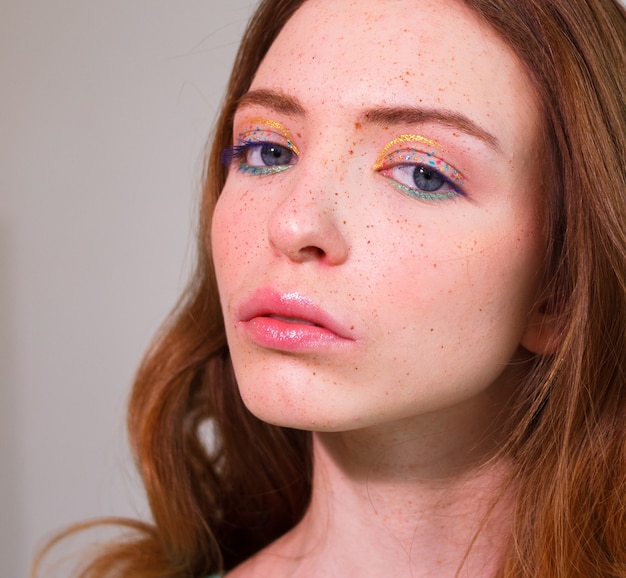 Young beautiful girl with bright makeup.