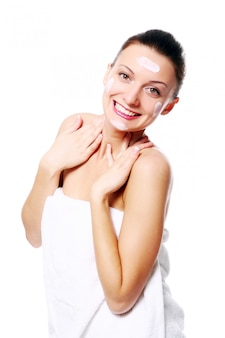 Young and beautiful happy woman relaxing in spa