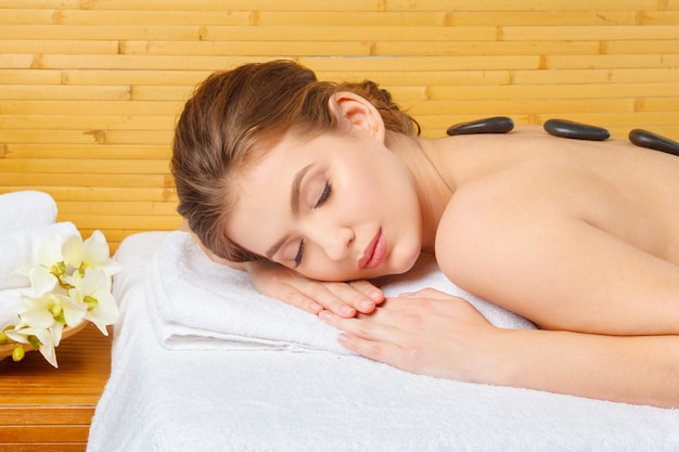 Young, beautiful and healthy woman in spa salon.