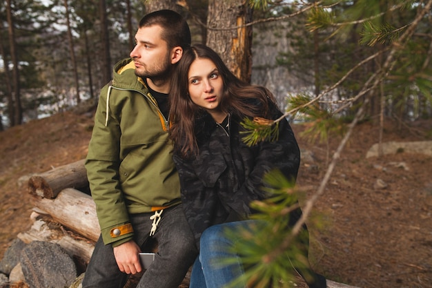 Young beautiful hipster man and woman in love traveling together in wild nature