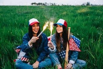 Young beautiful ladies celebrating 4th of July in field