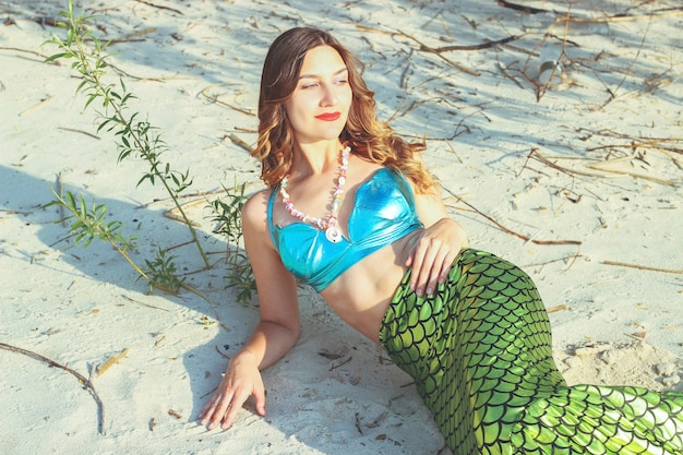 Young beautiful mermaid woman close up on the sea cost. cosplay mermaid.