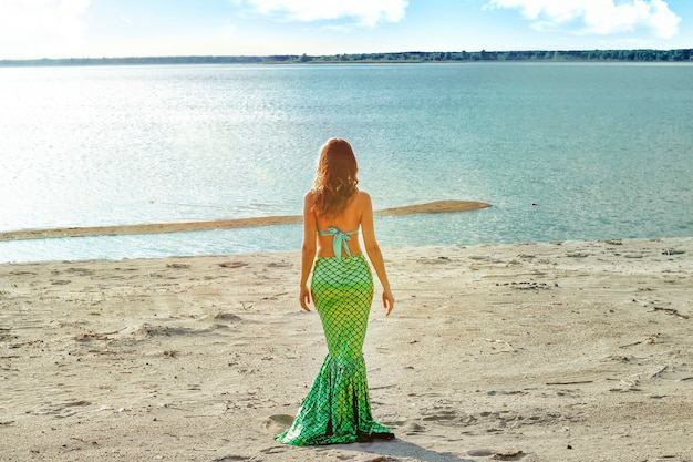 Young beautiful mermaid woman close up standing on the sea cost. cosplay mermaid.