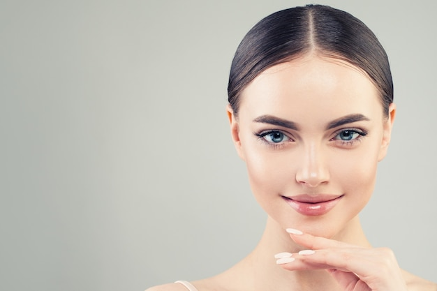 Young beautiful model woman with healthy skin portrait