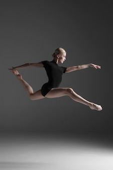Young beautiful modern style dancer jumping