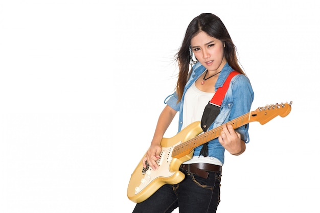Young and beautiful rock girl playing the electric guitar