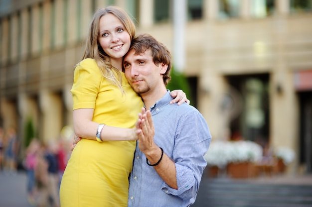 Young beautiful romantic couple portrait at city