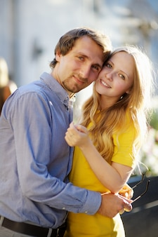 Young beautiful romantic couple portrait at sunny day
