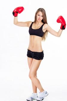 若い美しいセクシーな女の子。プロボクシングを扱っています。