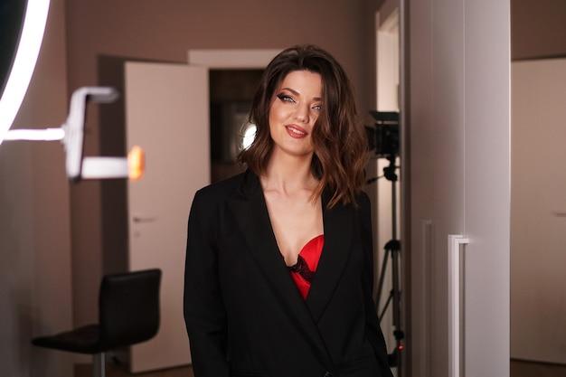 Young beautiful sexy model posing in photo studio. studio photo light