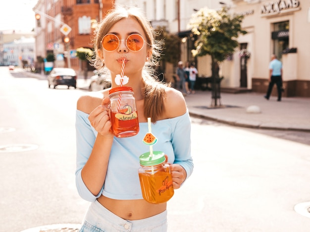 Young beautiful smiling hipster woman in sunglasses.