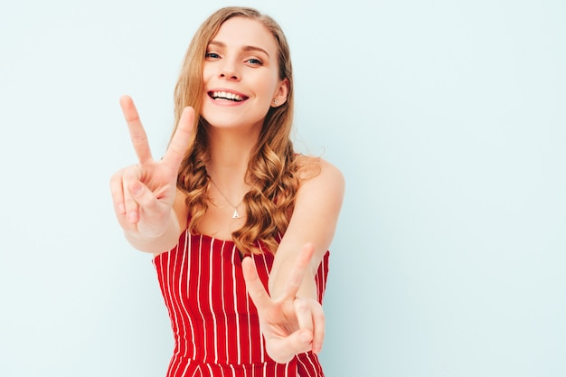 Young beautiful smiling woman in trendy summer clothes