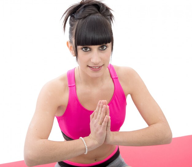 Young beautiful sporty girl meditates
