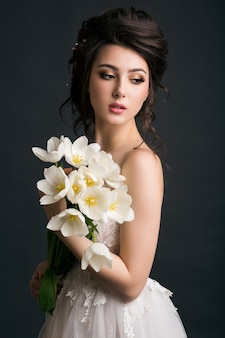 Young beautiful stylish woman in wedding dress