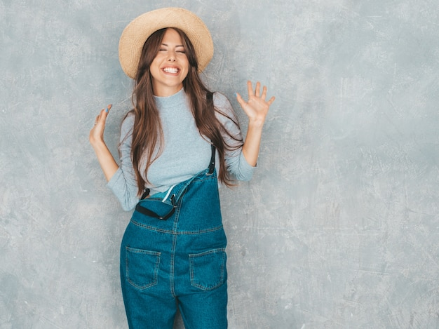 Young beautiful surprised woman looking  with hands in the air. trendy girl in casual summer clothes.