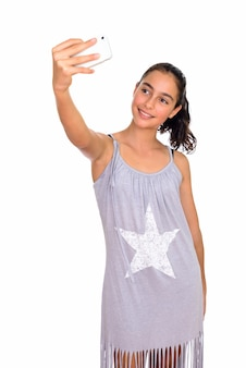 Young beautiful teenage girl wearing sleeveless dress isolated against white space