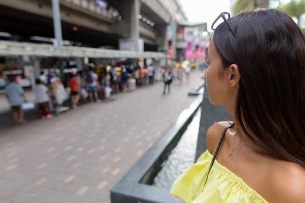 Young beautiful tourist woman exploring the city of bangkok