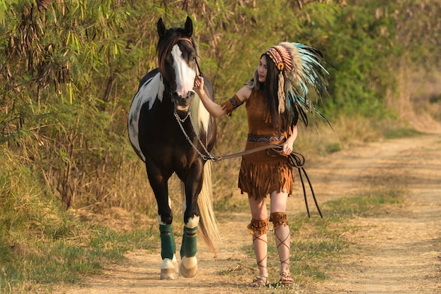 Young beautiful woman bohemian hippie style and horse.