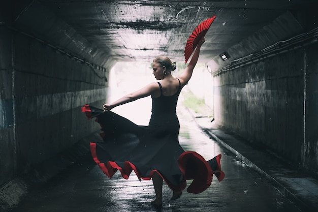 Young beautiful woman dancing flamenco