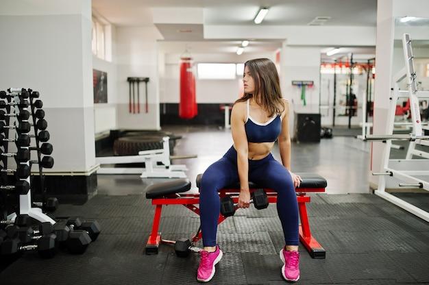 Young beautiful woman doing exercises