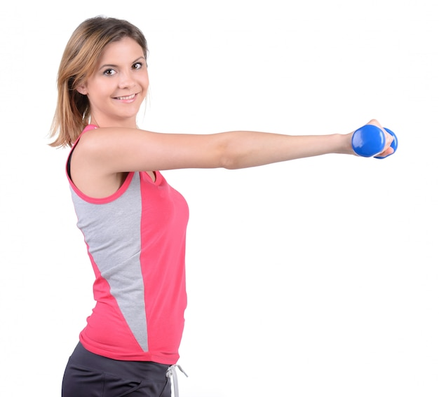 Young beautiful woman doing fitness exercise with dumbbells