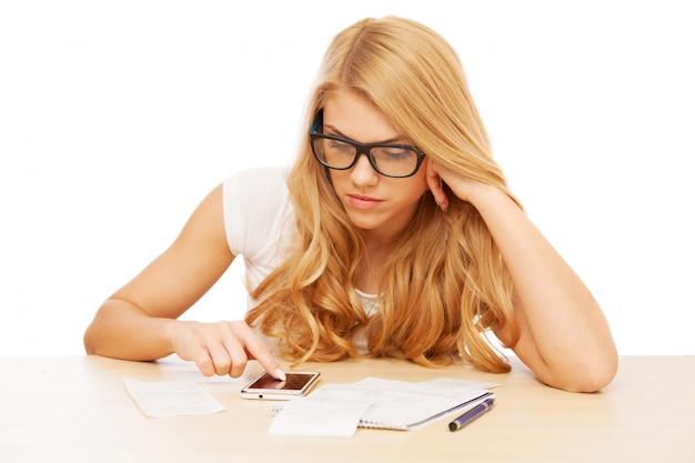 Young beautiful woman doing her accounts