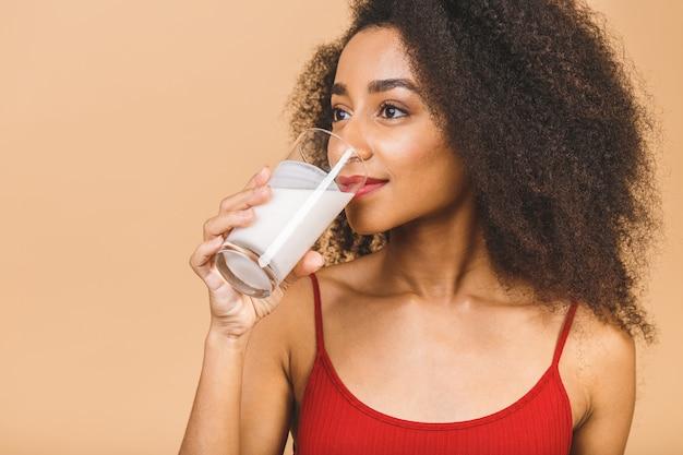Young beautiful woman eating yogurt as healthy breakfast or snack.