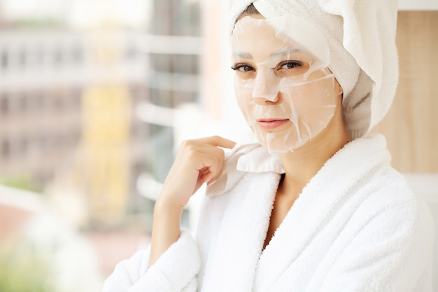 Young beautiful woman in a face mask, skin care.