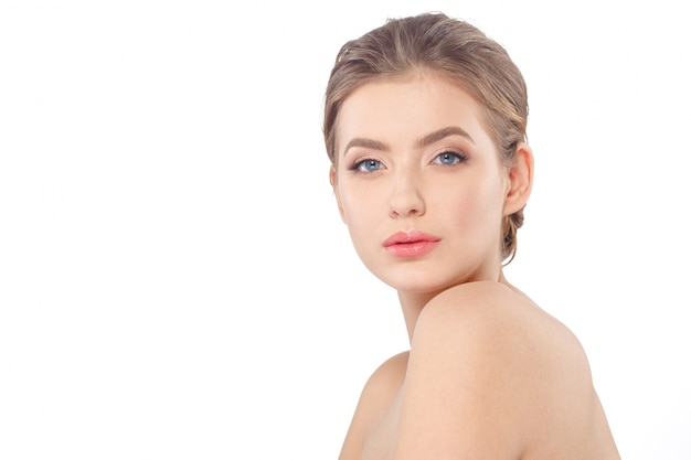 Young beautiful woman face portrait with healthy skin.