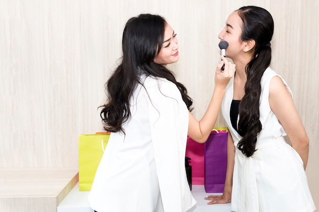 Young beautiful woman friendship test makeup with face for shipping.