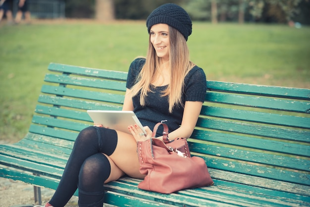 Young beautiful woman girl autumn using tablet
