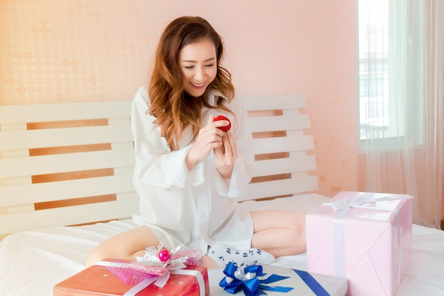 Young beautiful woman happy with ring in box