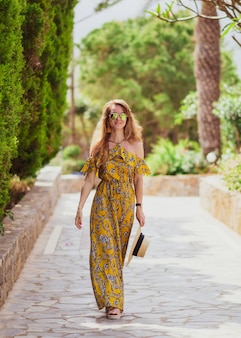 young beautiful woman hat yellow maxi dress sunny day vacation tropical nature greece crete island 106119 554