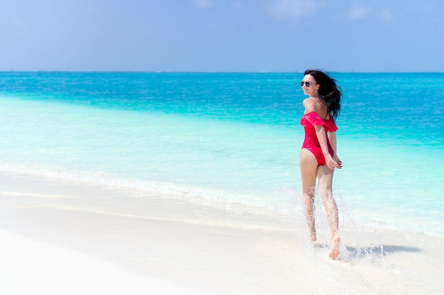 Young beautiful woman have fun on tropical seashore