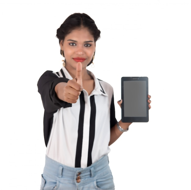 Young beautiful woman holding blank screen smart phone on white space
