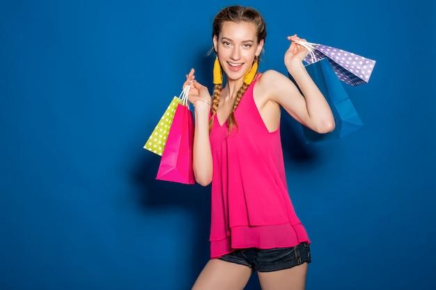 Young beautiful woman holding shopping bags