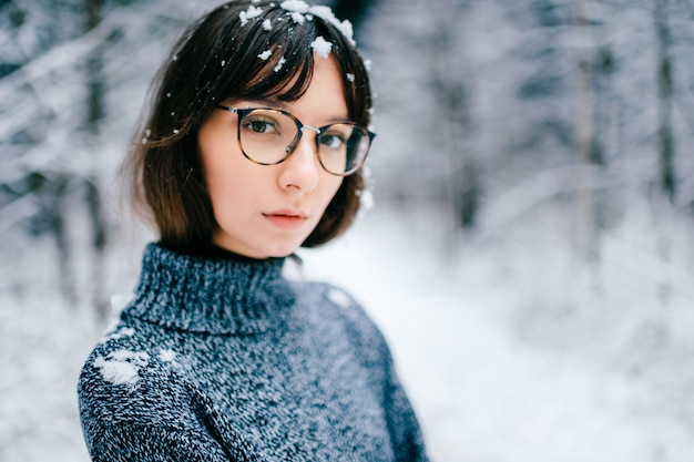 Young beautiful woman in knitted sweater in winter