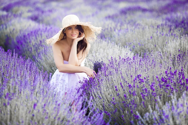 Young beautiful woman in lavender field. lady on summer background