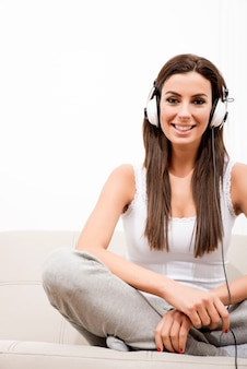 Young beautiful woman listening to audio