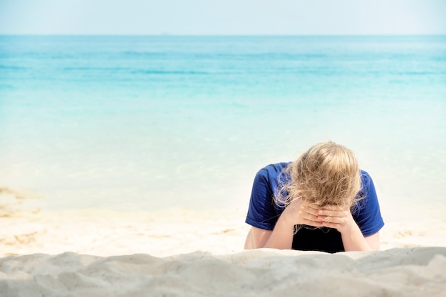 Young beautiful woman lonely on the beach.