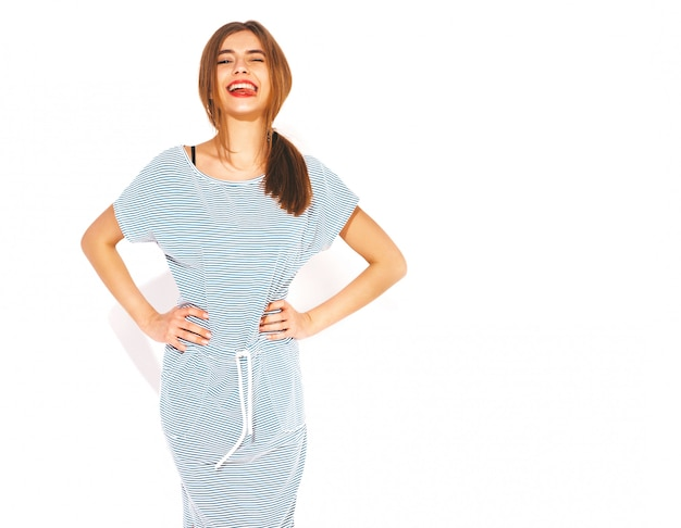 Young beautiful woman looking.trendy girl in casual summer zebra dress. positive funny model. showing tongue