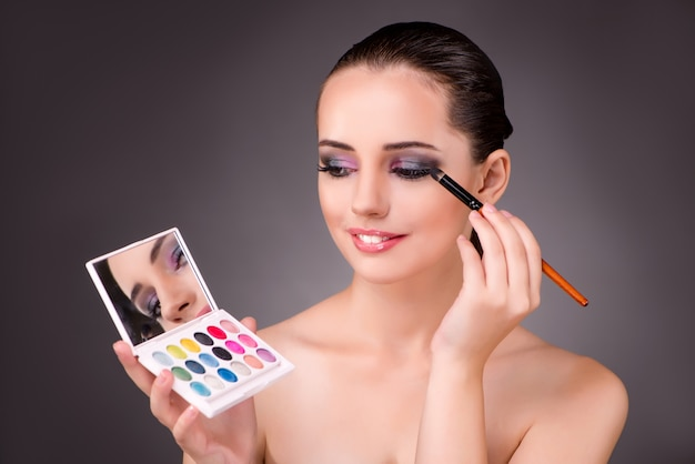 Young beautiful woman in make-up concept