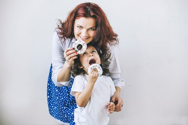 Young beautiful woman mother and daughter with toy a sweet happy close-up portraits