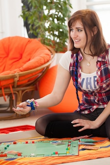 Young beautiful woman playing at home