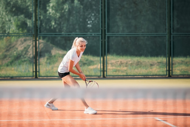 Young beautiful woman playing tennis on court. healthy sport lifestyle
