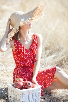Young beautiful woman portrait outdoors on juicy summer or autumn  female on fall time. lady on the nature wearing red stylish dress.