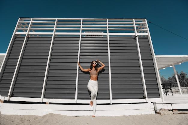 Young beautiful woman posing in the beach