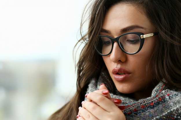 Young beautiful woman in a scarf portrait is
