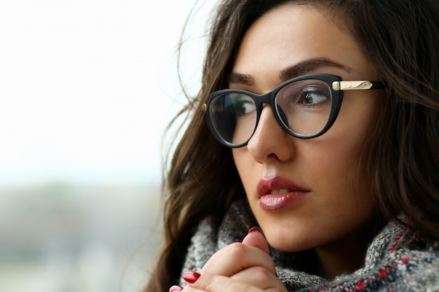 Young beautiful woman in a scarf portrait
